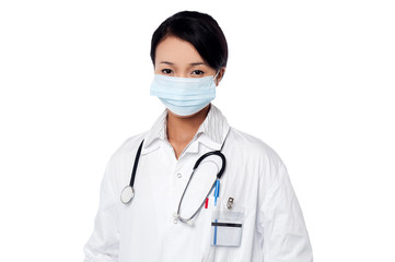 Young female surgeon wearing face mask