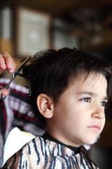 Young boy at barber shop
