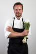 chef holding spring onions