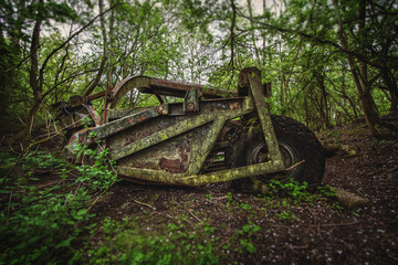 abandoned machine in woods