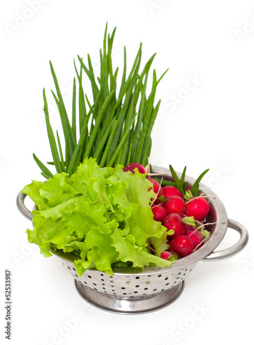 fresh garden vegetables in a colander