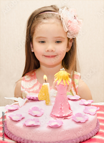 Portrait of little girl and her birthday cake