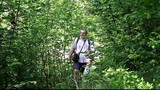 Hiker in the woods on trails /episode2/