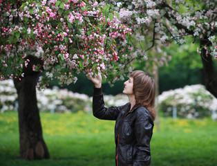 Girl in blooming park