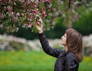Girl looking at blooming tree