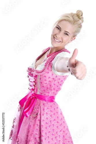 Hübsches blondes junges Mädchen isoliert im Trachtenkleid