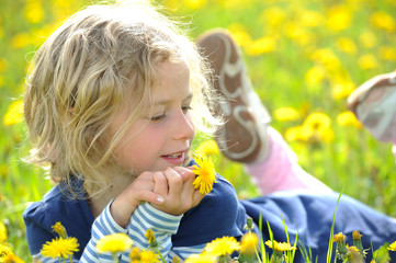 smiling girl in the spring- meadow