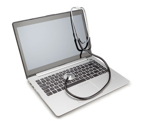 Medical stethoscope on a modern laptop, for the treatment of vir