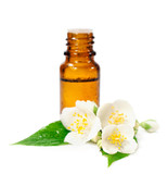bottle of essential oil and jasmine flowers