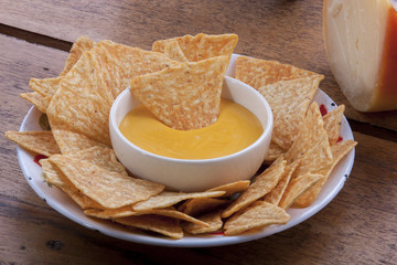 Corn chips and cheese sauce
