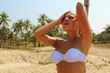 Beautiful blond woman under a beach shower