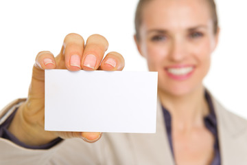 Closeup on business card in hand of smiling business woman