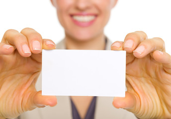 Closeup on business card in hand of happy business woman
