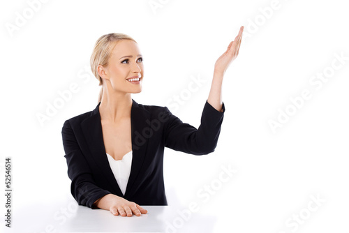 Blond business woman sitting at the desk