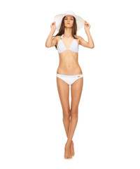 model posing in white bikini with hat