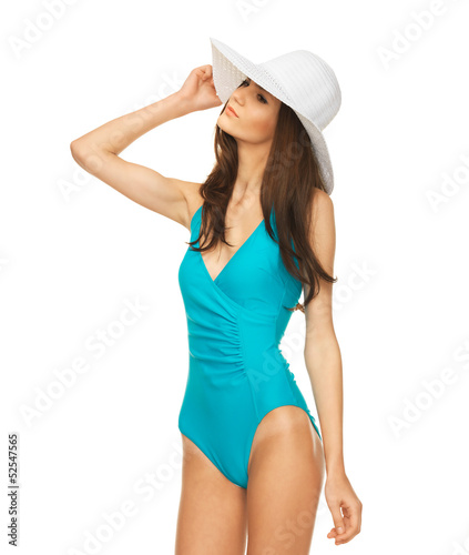 model posing in swimsuit with hat