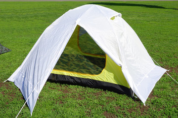 Dome two person tent on green grass