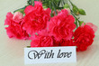 With love note and pink carnations
