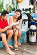 Dive master and student in Asian diving school