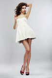 Fashion Style. Woman in Light White Dress. Summer Collection
