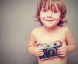 boy with an old camera