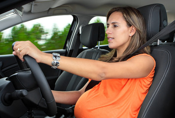 Pregnant Woman Driving a Car