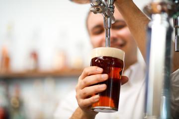 Bartender drawing a beer