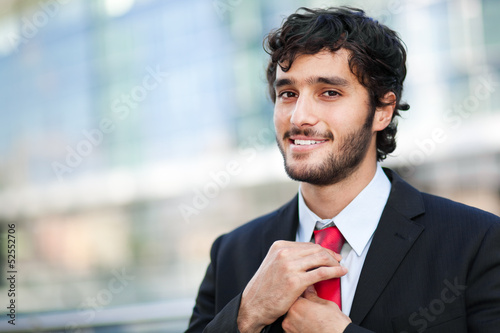 Confident businessman in an urban setting