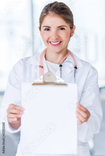 Doctor holding a prescription