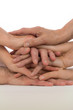 gestapelte Hände - Zusammenhalt