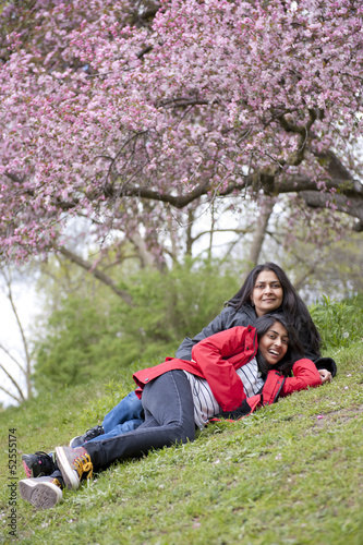 mother and daughter relaxing in park