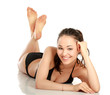 A beautiful woman in a black swimsuit is lying on the floor