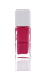 Pink nail polish bottle with reflection isolated on white backgr