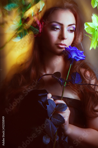 beautiful woman with red rose and blue lights