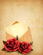 Two roses in front of an old envelope with a letter. Love letter