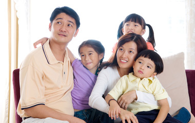Asian family looking upward