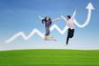 Couple jumping on profit chart cloud