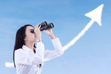 Businesswoman see success cloud with binoculars