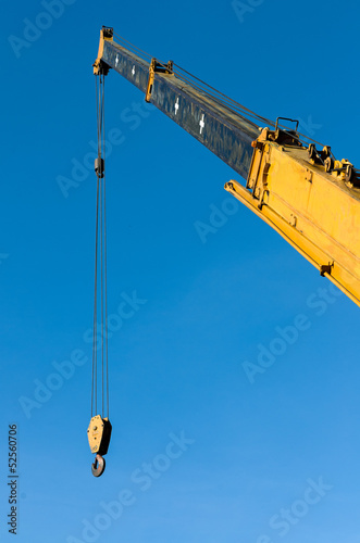 Yellow Tower crane with steel hook