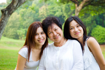 Outdoor portrait of Asian senior woman and daughter