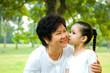 Asian girl kissing her grandmother