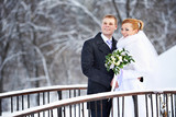 Happy bride and groom on winter day