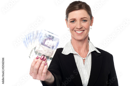 Corprorate woman holding currency notes