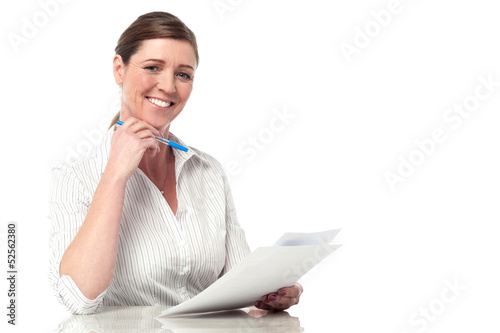 Female executive analyzing business reports