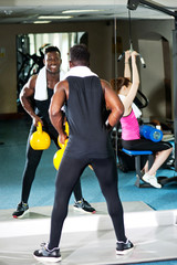 Fitness people working out with equipments