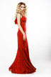 Luxury. Elegant Lady in Red Satiny Dress. Frizzy Blond Hair