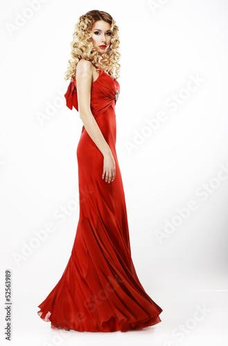 Luxury. Elegant Lady in Red Satiny Dress. Frizzy Blond Hair