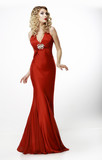 High Fashion. Blonde in Silk Evening Red Gown. Femininity