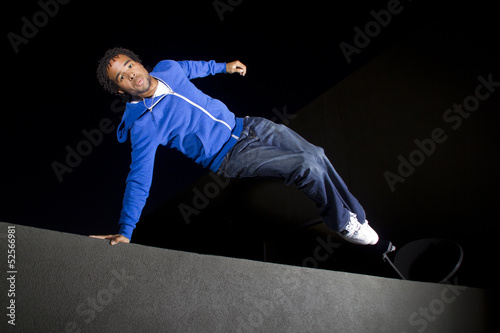 free runner doing parkour at night on a rooftop