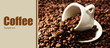 Cup of coffee on coffee beans close-up background